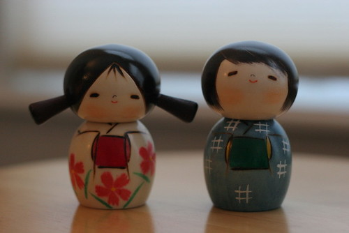 little girl and little boy kokeshi dolls
