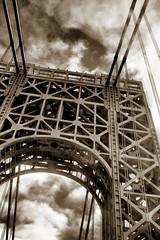 industry(0.0), truss bridge(0.0), black-and-white(0.0), amusement ride(0.0), roller coaster(0.0), amusement park(0.0), symmetry(1.0), architecture(1.0), monochrome photography(1.0), iron(1.0), monochrome(1.0),
