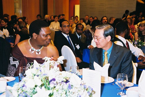HRH Prince Lonkhokhela Dlamini and Singapore's Minister for the Arts, Lee Boon Yang at delegates' dinner, second  World Summit on Arts & Culture, Singapore, November 2003
