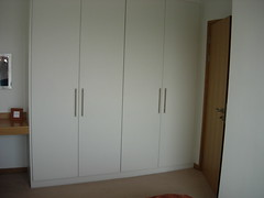 closet(1.0), furniture(1.0), room(1.0), cupboard(1.0), wardrobe(1.0), cabinetry(1.0),