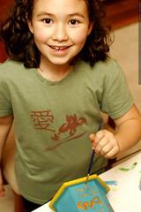 aidan painting her birdhouse    MG 1578