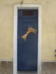 blue door with wheat