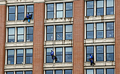 Window washers watching workers
