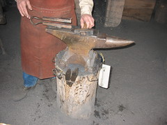 carving(0.0), forge(0.0), iron(1.0), person(1.0),