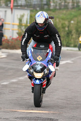 superbike racing(0.0), road bicycle racing(0.0), supermoto(0.0), racing(1.0), vehicle(1.0), sports(1.0), race(1.0), motorcycle(1.0), road racing(1.0), extreme sport(1.0), motorcycling(1.0), stunt performer(1.0), stunt(1.0), isle of man tt(1.0),