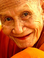 carving(0.0), grandparent(0.0), nose(1.0), face(1.0), temple(1.0), skin(1.0), senior citizen(1.0), head(1.0), close-up(1.0), wrinkle(1.0), person(1.0), portrait(1.0), smile(1.0), adult(1.0), organ(1.0),