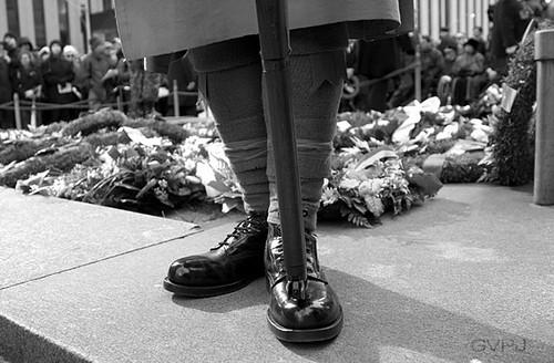 Wreaths at his feet