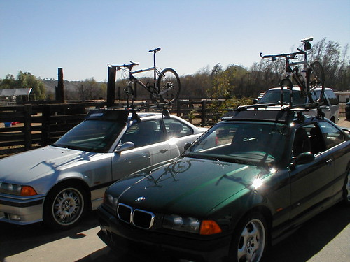 Two bikes, two cars, two roof racks