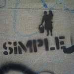 "A photo of some graffiti saying ""SIMPLE"""