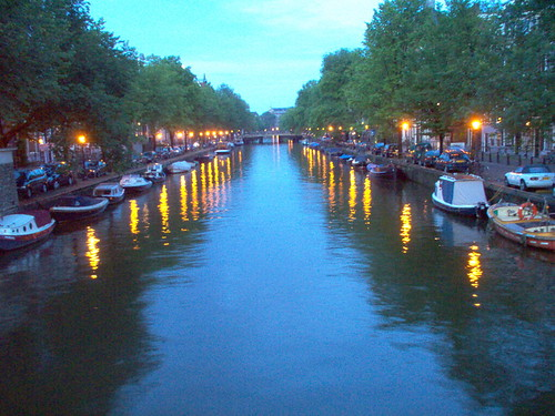 As the sun goes down in Amsterdam the street lights illuminate the Prinsengracht Canal.