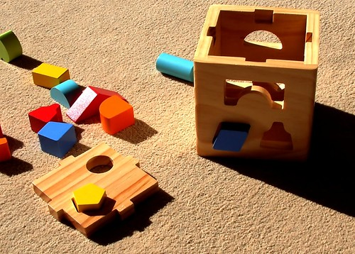 An occupational therapist describes 7 of the best toys for toddlers that will help encourage their overall development.