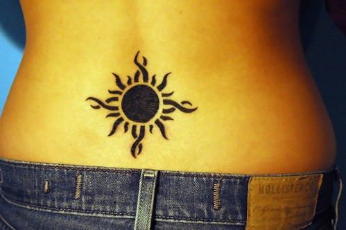 Amazing lower back sun tribal tattoo for The girl with the lower back tattoo review