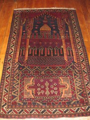 rug(1.0), tapestry(1.0), floor(1.0), art(1.0), prayer rug(1.0), wood flooring(1.0), hardwood(1.0), carpet(1.0), flooring(1.0),