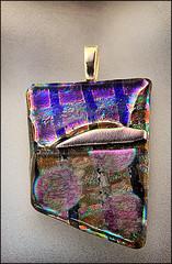 handbag(0.0), glitter(0.0), bling-bling(0.0), organ(0.0), art(1.0), pattern(1.0), purple(1.0), violet(1.0), coin purse(1.0), jewellery(1.0),