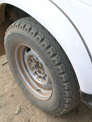 bumper(0.0), spoke(0.0), tire(1.0), automotive tire(1.0), automotive exterior(1.0), wheel(1.0), synthetic rubber(1.0), tread(1.0), rim(1.0), alloy wheel(1.0),