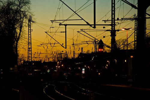trees winter sunset sky orange sun industry nature topf25 colors station yellow digital germany geotagged dawn evening interestingness nikon colorful europe bonn afternoon seasons searchthebest tl branches tracks silhouettes atmosphere railway explore wires getty wired onecolor d200 nikkor dslr gettyimages northrhinewestphalia interestingness29 i500 18200mmf3556 utatafeature manganite nikonstunninggallery ipernity thecolororange date:year=2007 geo:lat=50732559 geo:lon=7094749 date:month=march date:day=11