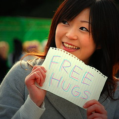 "Girl holding a ""Free Hugs!"" sign"