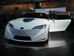 automobile(1.0), automotive exterior(1.0), toyota(1.0), exhibition(1.0), vehicle(1.0), performance car(1.0), automotive design(1.0), auto show(1.0), bumper(1.0), toyota ft-hs(1.0), concept car(1.0), land vehicle(1.0), supercar(1.0), sports car(1.0),