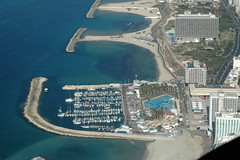 port(1.0), bird's-eye view(1.0), dock(1.0), artificial island(1.0), aerial photography(1.0), marina(1.0),