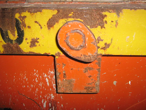 iron container with colors and rust