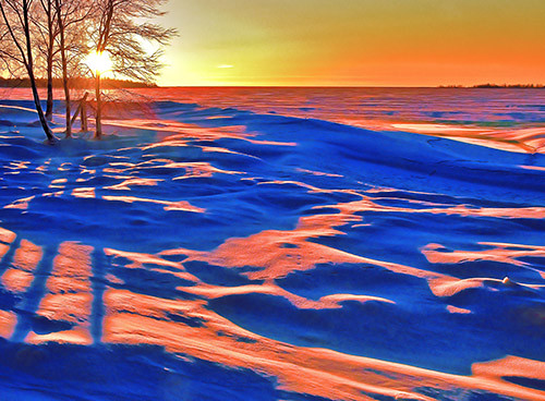 Cold winter evening on the snowy seashore