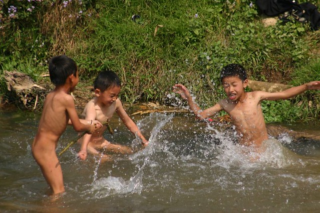Boys playing naked in the river. Xam Neau. 2007.