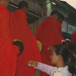Monks Receiving Food at Dawn - Luang Prabang, Laos