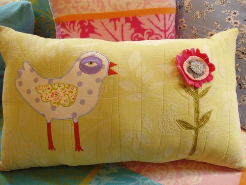 bird with flower pillow