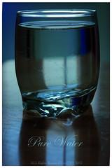 wine glass(0.0), glass bottle(0.0), pint glass(0.0), stemware(0.0), bottle(0.0), pint (us)(0.0), old fashioned glass(1.0), drinkware(1.0), distilled beverage(1.0), cobalt blue(1.0), glass(1.0), drink(1.0), blue(1.0),