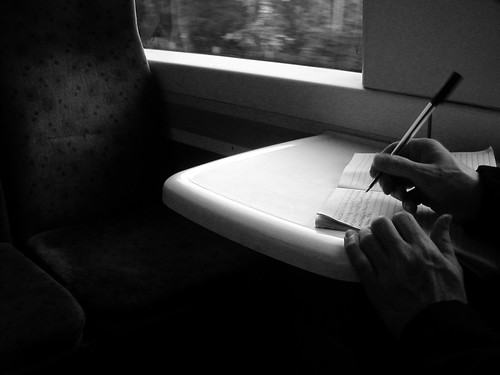 unknown person writing diary of unknown journey