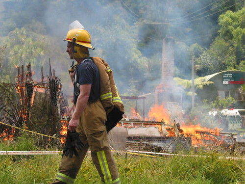 A Fireman In Front Of Burnt House (Credit: Kiwi NZ on Flickr.com)
