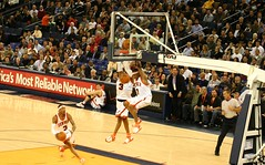 cheering(0.0), cheerleading(0.0), championship(1.0), sports(1.0), basketball moves(1.0), team sport(1.0), basketball player(1.0), ball game(1.0), basketball(1.0), slam dunk(1.0),