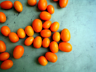 kumquats on a desk