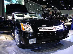 sedan(0.0), coupã©(0.0), supercar(0.0), automobile(1.0), automotive exterior(1.0), cadillac(1.0), wheel(1.0), vehicle(1.0), performance car(1.0), automotive design(1.0), auto show(1.0), cadillac xlr-v(1.0), bumper(1.0), land vehicle(1.0), luxury vehicle(1.0), sports car(1.0),