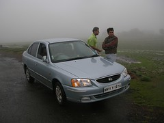 toyota(0.0), automobile(1.0), automotive exterior(1.0), hyundai(1.0), vehicle(1.0), hyundai accent(1.0), mid-size car(1.0), compact car(1.0), sedan(1.0), land vehicle(1.0),