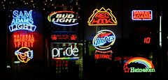 slot machine(0.0), machine(1.0), signage(1.0), electronic signage(1.0), neon(1.0), neon sign(1.0),