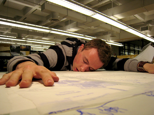 An exhausted designer in a studio.