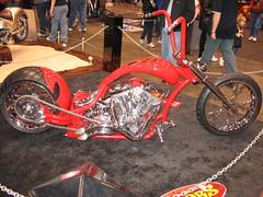 racing(0.0), bmx bike(0.0), dirt track racing(0.0), stunt performer(0.0), motorcycle speedway(0.0), bicycle(0.0), wheel(1.0), vehicle(1.0), race(1.0), motorcycle(1.0), chopper(1.0), land vehicle(1.0),