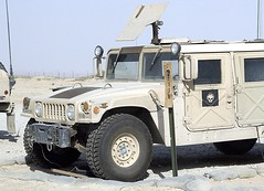 truck(0.0), armored car(1.0), army(1.0), automobile(1.0), automotive exterior(1.0), military vehicle(1.0), sport utility vehicle(1.0), vehicle(1.0), hummer h1(1.0), off-roading(1.0), armored car(1.0), humvee(1.0), off-road vehicle(1.0), land vehicle(1.0), military(1.0),
