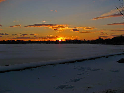 Sun setting of frozen tidal basin