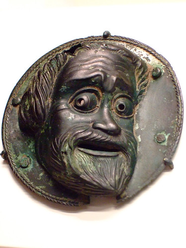 Roundel with a comic mask Greek from South Italy about 300 BCE Bronze