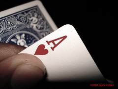 arm(0.0), brand(0.0), hand(1.0), finger(1.0), poker(1.0), games(1.0), gambling(1.0), close-up(1.0),