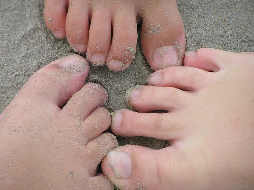kid feet on beach