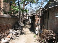 ruins(0.0), waterway(0.0), village(1.0), shack(1.0), alley(1.0), rural area(1.0), slum(1.0),