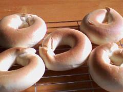 dish(0.0), dessert(0.0), doughnut(1.0), baking(1.0), baked goods(1.0), food(1.0), cuisine(1.0), snack food(1.0), bagel(1.0),