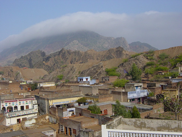MOUNTAIN COVERED WITH CLOUDS IN JALALPUR SHARIF; District Jhelum, Punjab - Pakistan