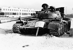 armored car(0.0), churchill tank(0.0), combat vehicle(1.0), military vehicle(1.0), weapon(1.0), vehicle(1.0), tank(1.0), self-propelled artillery(1.0), gun turret(1.0), land vehicle(1.0), monochrome(1.0), military(1.0), black-and-white(1.0),