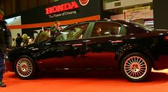 alfa romeo giulietta(0.0), sports car(0.0), automobile(1.0), alfa romeo(1.0), executive car(1.0), family car(1.0), wheel(1.0), vehicle(1.0), automotive design(1.0), alfa romeo 159(1.0), auto show(1.0), mid-size car(1.0), compact car(1.0), sedan(1.0), land vehicle(1.0), luxury vehicle(1.0),