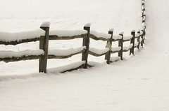 post and rail in snow