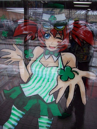 The Anime Stop store mascot character wearing a St. Patrick's Day outfit.